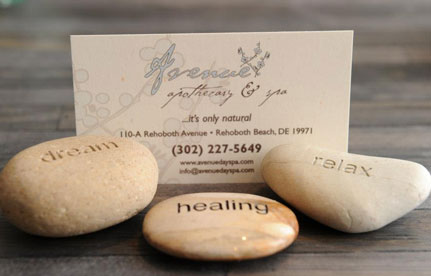 Image of 3 rocks with the words Dream, Healing, and Relax carved into them.