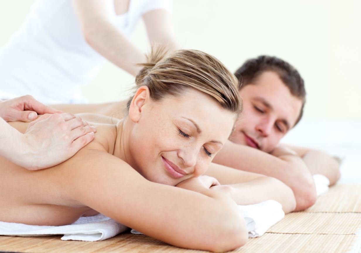 A couple getting a massage.